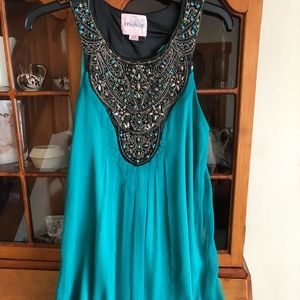 Beautiful, embroidered turquoise dress.